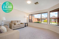 Delightful two-bedroom home with ducted air conditioning and open plan living.