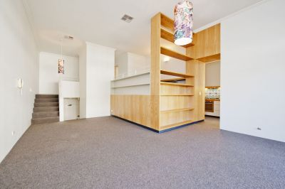 Townhouse-Style Apartment in Highly Sought-After Locale