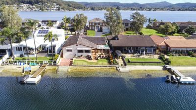 Spacious North Facing Waterfront Home with Boat Shed