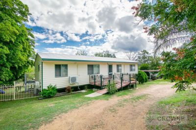 ACREAGE LIVING WITH SHEDS GALORE!
