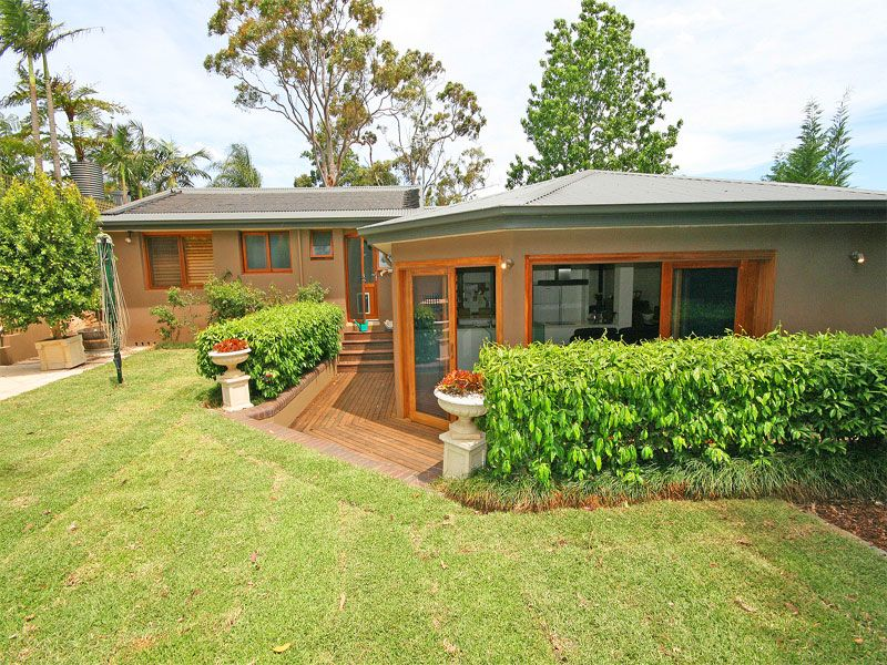SOLD BY KAREN ALLMARK IN CONJUNCTION. REAL ESTATE. ABSOLUTELY STUNNING contemporary home on large block