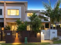 MODERN LOW MAINTENANCE HOME IN PRIME LOCATION!!