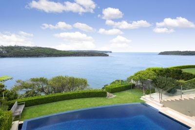 Waterfront trophy home with spellbinding harbour views.