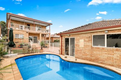 Large double brick family home in a premium tree lined street just footsteps to Majors Bay Road's café's and North Strathfield Station