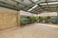 Immaculate Villa with huge undercover entertaining area and lovely garden.
