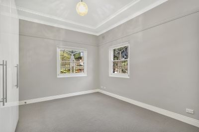 Conveniently Located Two Bedroom Plus Sunroom Apartment