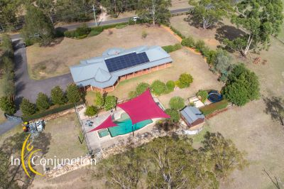 executive lifestyle property on 25 acres with large shed and resort-style pool