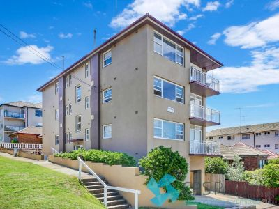 SUNNY UPDATED TWO BEDROOM IN PREMIER BEACH-SIDE LOCATION