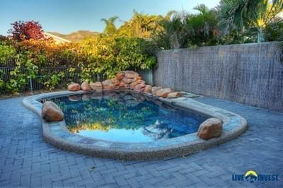 Tropical inground pool & established gardens