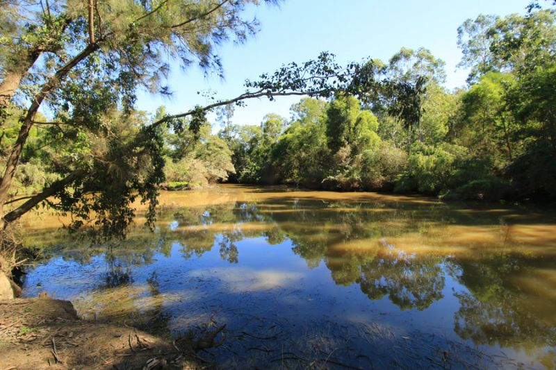 Private and secluded paradise on 52 acres with rare small boat access to Cattai Creek.