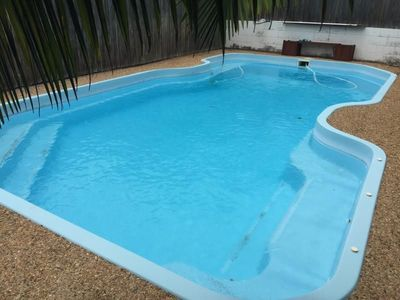 LOOK AT ME ! I have a big pool & loads of storage & garage space...
