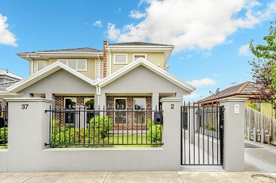 As new 2 storey townhouse with security gate entrance to double garage.