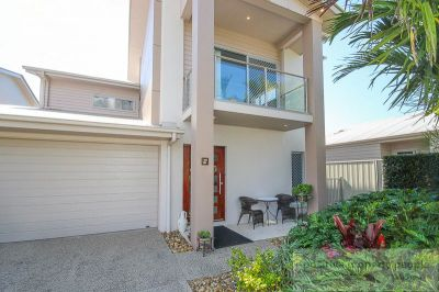 Dual Living Potential in Gated Community!