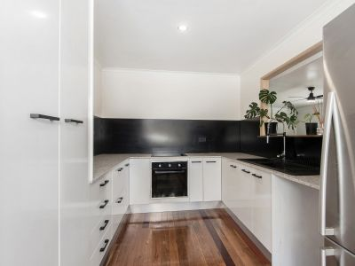 RENOVATED MASTERPIECE WITH TWO STREET FRONTAGE!
