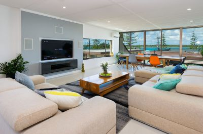 Spectacular Broadwater Three Level Villa with Full Renovations and Dual Living!