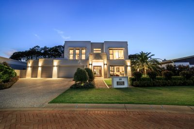 Beautifully located in a quiet cul-de-sac in the middle of two Golf Courses