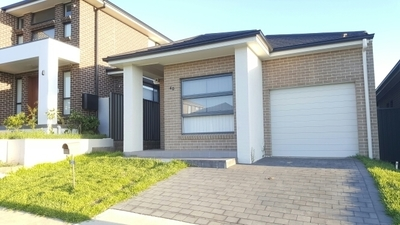 Modern three bedroom split level family home located in Gregory Hills.