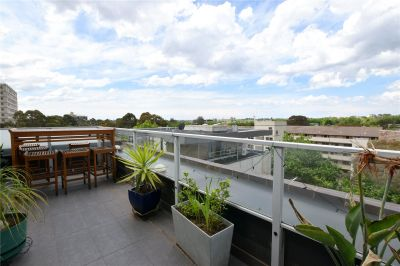 Modern Top Floor Apartment with Large Terrace in Prime Location!