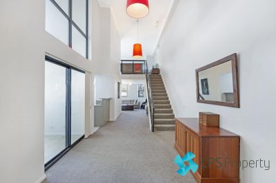 LARGE ONE BEDROOM LOFT-STYLE RESIDENCE IN POPULAR PARKSIDE LOCATION