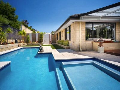 STUNNING FAMILY HOME WITH RESORT STYLE POOL AREA