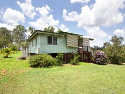 Neat Queenslander on 5,107m2 - Peaceful small acreage living!