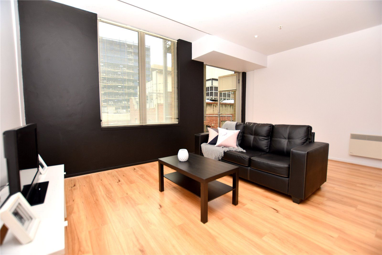 Executive Partially-Furnished Apartment in the Perfect Location!