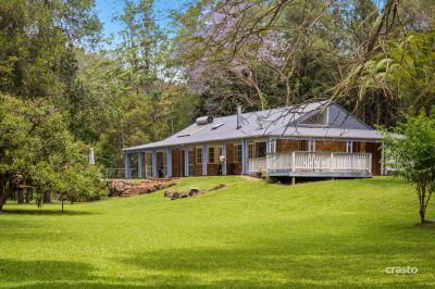 A truly special Property on 2 acres with creek frontage