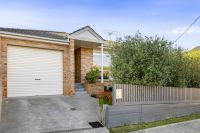Low maintenance brick home in coveted family neighbourhood