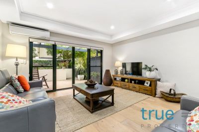 BOUTIQUE, PRIVATE AND SPACIOUS TRI-LEVEL TOWNHOUSE