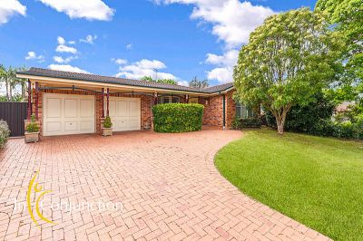 delightful single level 4 bedroom home boasting generous floor-space, lovely gardens and large covered entertaining area