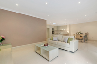 Stylish three bedroom villa with a delightful North facing decked courtyard.