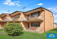 Bright 2 Bedroom Townhouse. 2 Bathrooms. Sunny Private Courtyard. Great Location. Bus stop at door. Walk to Parramatta