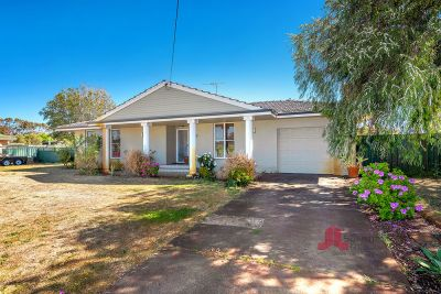 RARE OPPORTUNITY WITH STUDIO & HORSE STABLES!