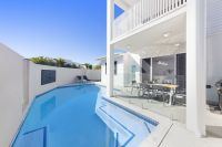 Options Aplenty With This Premium Beachfront Home