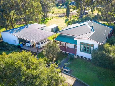 Residential home w/ large Garage and Shed. Plenty of land