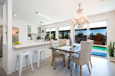 MAXIMUM BUSINESS EXPOSURE AND WATERFRONT RESIDENCE