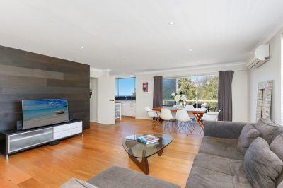 Designer Apartment with Sparkling Ocean Views