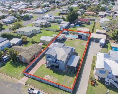 STUNNING DUAL LIVING QUEENSLANDER WITH POOL, SOLAR & SHED ON 1,012M2!