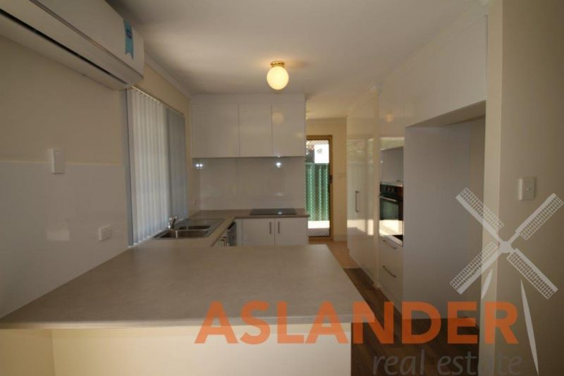 RENOVATED LOW MAINTENANCE, ENERGY EFFICIENT FRONT VILLA TO DELIGHT
