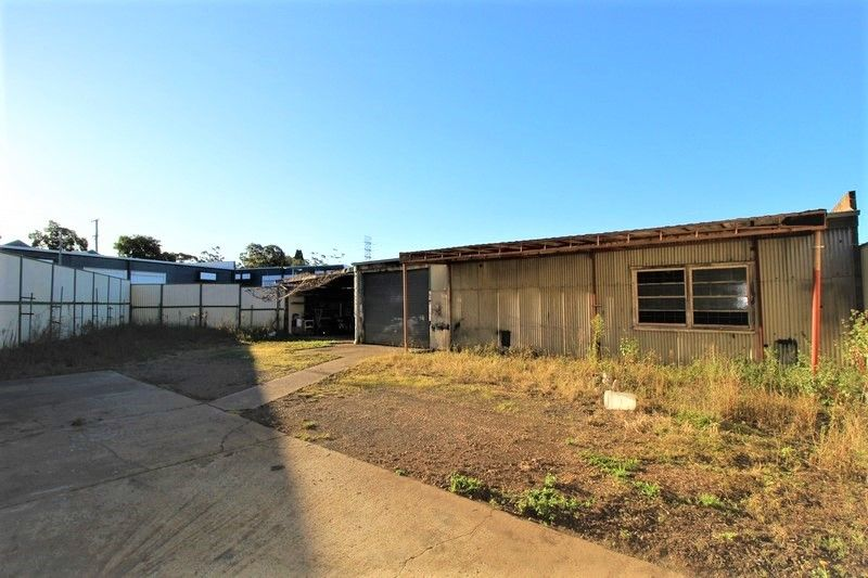 AFFORDABLE WAREHOUSE SPACE + LARGE YARD!