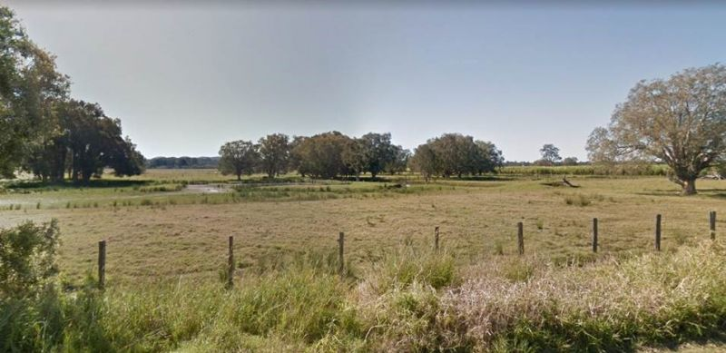 STUNNING RURAL ACREAGE WITH RIVER FRONTAGE