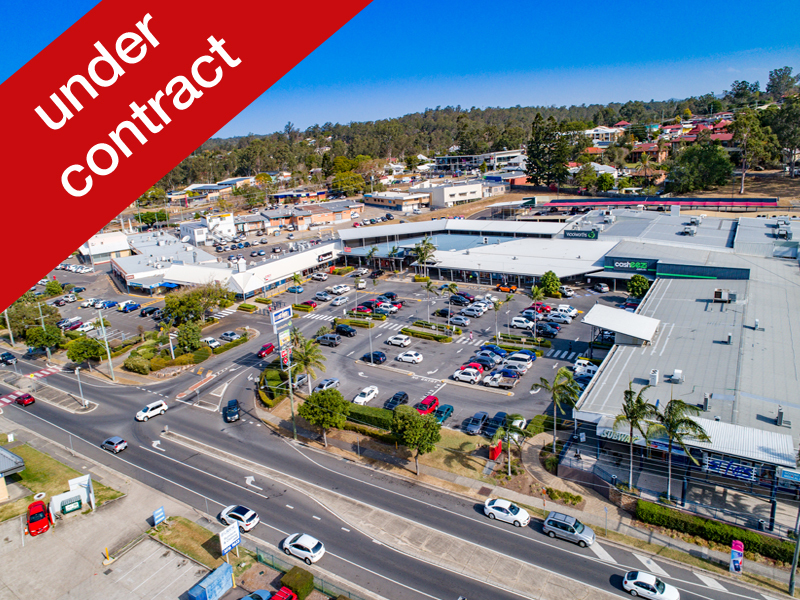 Woolworths Shopping Centre Plus 6 Adjoining Properties - Value Add Opportunity