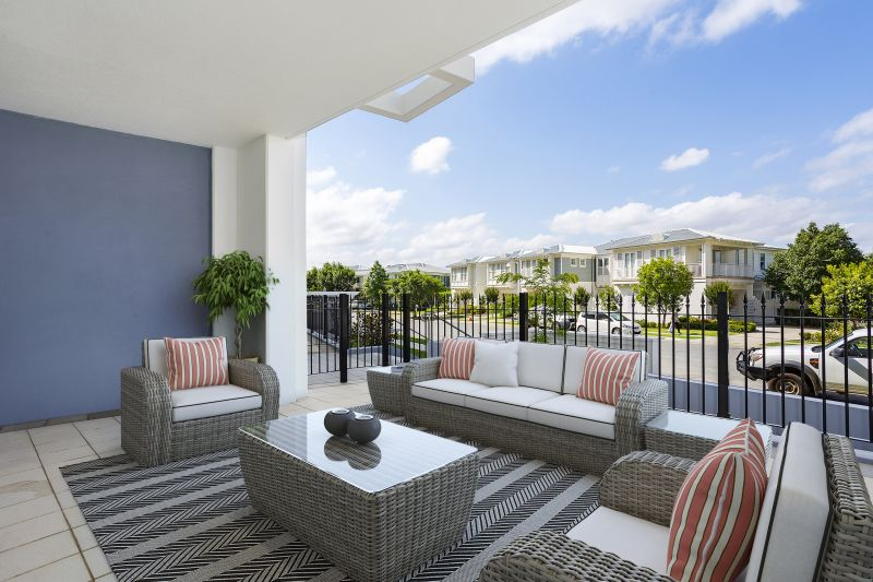 Stylish ground floor apartment in highly sought waterside community