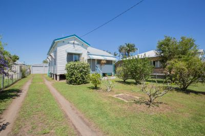 EXCELLENT STARTER HOME OR INVESTMENT WITH 3 BAYS OF SHED SPACE!