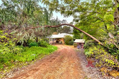 ESCAPE TO THE COUNTRY ON JUST UNDER 5 ACRES!