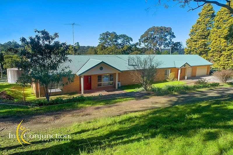 Delightful 6 bedroom single level home on 6.5 acres privately positioned in a magnificent setting.