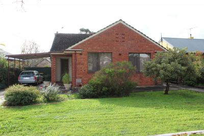 Solid home and big block with loads of potential!