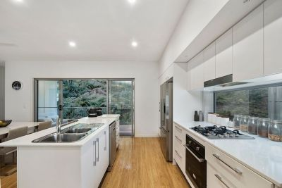 IMMACULATE TERRACE STYLE HOUSE LOCATED ON CURRUMBIN HILL.