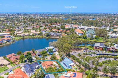 Large Family home in Robina's finest street!