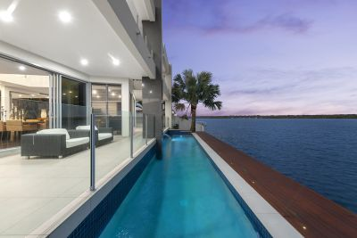 Architecturally Designed, Tri-Level Residence In An Unbeatable Broadwater Position!